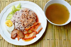 Barbecued red pork in sauce with brown rice and soup Royalty Free Stock Images