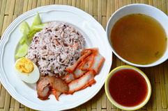 Barbecued red pork in sauce with brown rice and soup Royalty Free Stock Photos