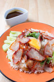 Barbecued red pork in sauce with rice Stock Photography