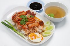 Barbecued red pork in sauce with rice, Chinese style roasted. Pork stock photography