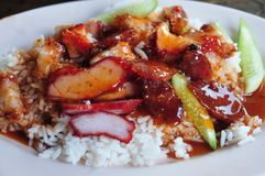 Barbecued red pork in sauce with rice. Thai Style Red Barbecue Pork over Rice with Red Sauce, Khao Moo Dang stock photo