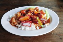 Barbecued red pork in sauce with rice. Thai Style Red Barbecue Pork over Rice with Red Sauce, Khao Moo Dang royalty free stock photo