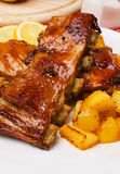 Barbecued ribs with baked potato. Delicious barbecued honey glazed ribs with baked potato Royalty Free Stock Images