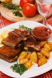 Barbecued ribs with baked potato Royalty Free Stock Photo