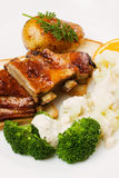 Barbecued ribs with cauliflower and broccoli Stock Photography