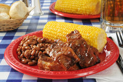 Barbecued ribs with corn on the cob Royalty Free Stock Photo
