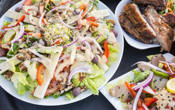 Barbecued Ribs, Smoked Tuna and Salad Royalty Free Stock Photos