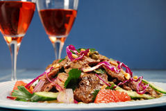 Barbecued steak salad and wine Royalty Free Stock Photos