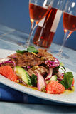 Barbecued steak salad and wine Stock Photos