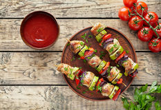 Barbecued turkey or chicken meat shish kebab skewers with ketchup Stock Images