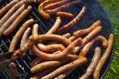 Barbecueing frankfurters Стоковое Фото