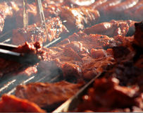 Barbecues. Meat frying on the furnace - barbecues - grill party Stock Photo