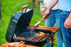 Barbecuing мясо к совершенству Стоковое Фото