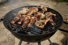 Barbecuing chicken Royalty Free Stock Photography