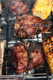 Barbecuing chops Stock Image