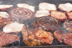 Barbecuing minced meat on charcoal fire closeup image. Royalty Free Stock Images