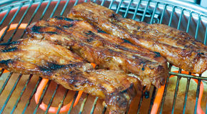 Barbecuing a pork belly Stock Photo