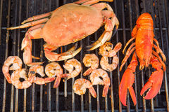 Barbecuing Red Lobster, Crab and Jumbo Shrimps Stock Photos