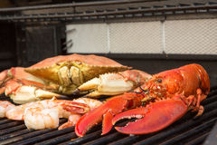 Barbecuing Red Lobster, Crab and Jumbo Shrimps Stock Image