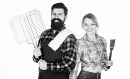 Barbecuing to perfection. Tools for roasting meat. Family weekend. Man bearded hipster and girl. Preparation and royalty free stock photos