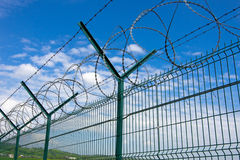 Barbed fence Stock Photo