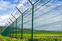 Barbed fence Stock Images