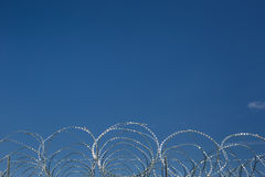 Barbed and razor wire Stock Images