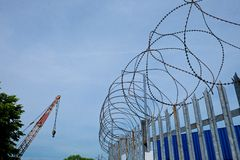 Barbed Razor Wire on Metal Security Fence Royalty Free Stock Photo