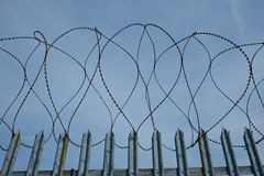 Barbed Razor Wire on Metal Security Fence Stock Image