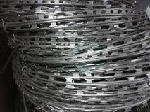 Barbed steel wire are prepared for sales gray background stock photos
