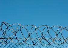 Barbed wire. And blue sky Royalty Free Stock Photo