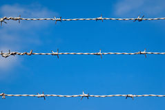 Barbed wire. Against blue sky Stock Photos