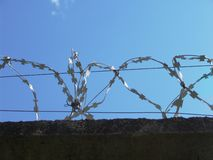 Barbed wire 2. Razor wire above a wall Royalty Free Stock Image