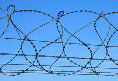 Barbed wire. (barbwire) against blue sky stock photo