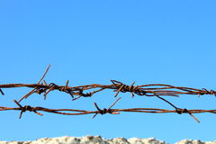 Barbed wire. Against the blue sky Royalty Free Stock Image