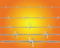Barbed wire. On an orange background Stock Images