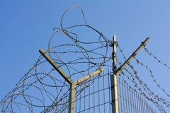 Barbed wire. Against blue sky Royalty Free Stock Photos