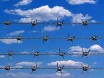 Barbed wire. Conceptual barbed wire on clouded sky in background - 3d render Stock Photos