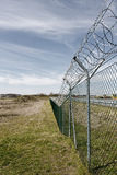 Barbed Wire. Barb wire around an airport area in nuremberg, germany Royalty Free Stock Photos
