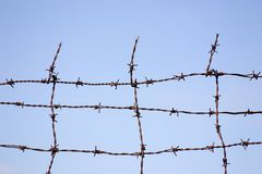 Barbed wire. As a barrier Stock Photos