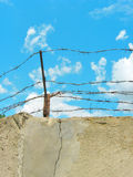 Barbed wire. (photo of wall and sky Royalty Free Stock Images