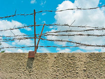 Barbed wire. (photo of wall and sky Royalty Free Stock Photography