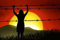 Barbed wire. Woman is captured behind barbed wire Royalty Free Stock Images