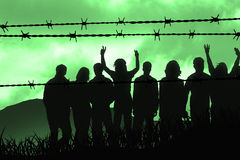 Barbed wire. People are captured behind barbed wire Royalty Free Stock Image