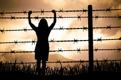Barbed wire. People are captured behind barbed wire Stock Photography