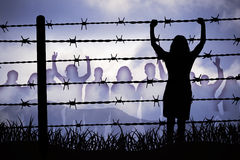 Barbed wire. People are captured behind barbed wire Royalty Free Stock Photography