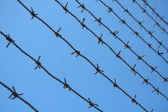 Barbed Wire. Over blue sky Royalty Free Stock Photo