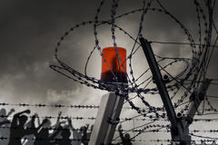 Barbed wire. The barbed wire with clouds and light Royalty Free Stock Photo