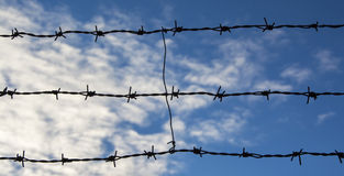 Barbed wire. Against blue sky Royalty Free Stock Photo
