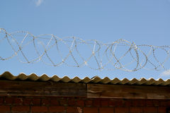 Barbed wire against the blue sky Stock Images